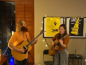 Piper and Carson performing in the Face the Music Room